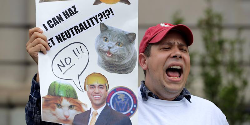 net neutrality protest ajit pai picture cat