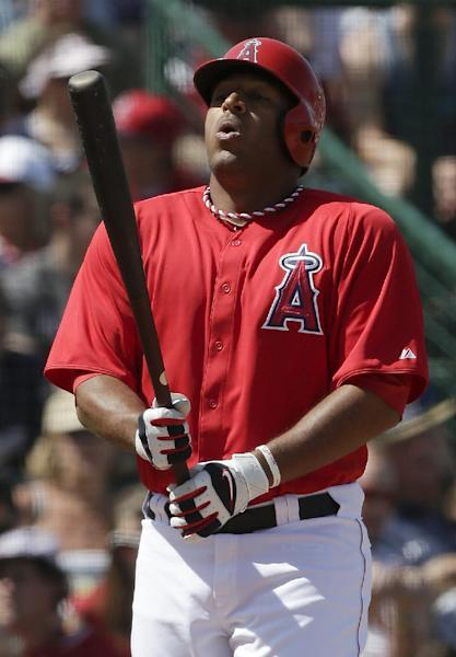 In this photo taken March 23, 2013, Los Angeles Angels' Vernon Wells bats against the Milwaukee Brewers during the third inning of a spring training baseball game in Tempe, Ariz. Wells might become the latest addition to the New York Yankees' injury-depleted lineup. (AP Photo/Chris Carlson)