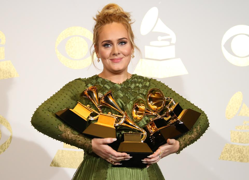 """LOS ANGELES, CA - FEBRUARY 12: Singer Adele poses in the press room with her awards for Album Of The Year and Best Pop Vocal Album for """"25"""" and Song Of The Year, Record Of The Year and Best Pop Solo Performance for """"Hello"""" at The 59th GRAMMY Awards at Staples Center on February 12, 2017 in Los Angeles, California. (Photo by Dan MacMedan/WireImage)"""