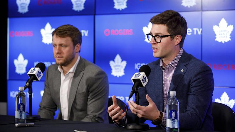 Toronto Maple Leafs defenceman Morgan Rielly, left, looks on alongside General Manager Kyle Dubas as they address an NHL investigation into an alleged slur during last night's game against the Tampa Bay Lightning, in Toronto, Tuesday, March 12, 2019. THE CANADIAN PRESS/Cole Burston