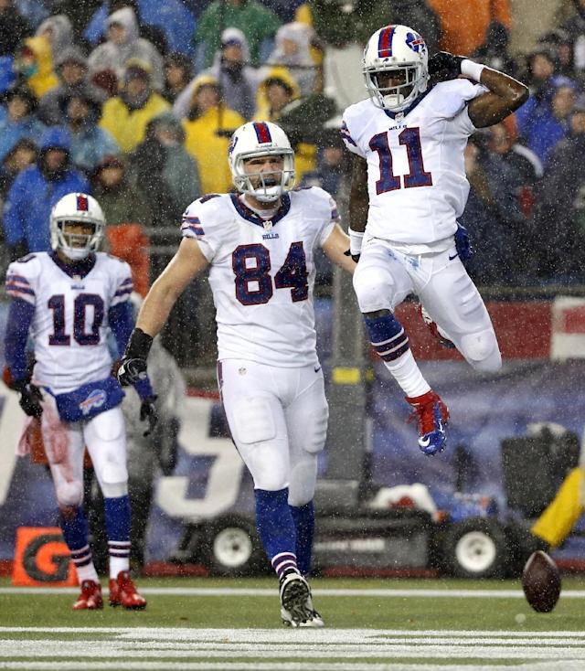 Buffalo Bills wide receiver T.J. Graham (11) celebrates his touchdown catch with Robert Woods (10) and Scott Chandler (84) in the third quarter of an NFL football game against the New England Patriots, Sunday, Dec. 29, 2013, in Foxborough, Mass. (AP Photo/Elise Amendola)