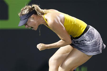 Maria Sharapova reacts during her match against Lucie Safarova (not pictured) on day six of the Sony Open at Crandon Tennis Center. Mandatory Credit: Geoff Burke-USA TODAY Sports