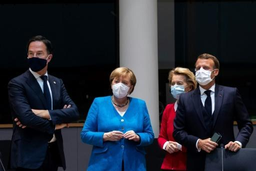 Netherlands' Prime Minister Mark Rutte (L) was faced with pressure to loosen his purse strings from Germany's Chancellor Angela Merkel ( 2nd L), President of the European Commission Ursula von der Leyen (2nd R) and France's President Emmanuel Macron