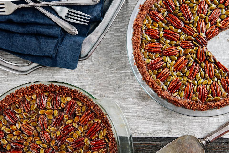"""Earthy and sweet with molasses, rich with cream, and bittersweet with dark chocolate, this sophisticated pie is a breeze to make. <a href=""""https://www.epicurious.com/recipes/food/views/chocolate-pecan-and-pumpkin-seed-pie-with-gingersnap-crust-56390158?mbid=synd_yahoo_rss"""" rel=""""nofollow noopener"""" target=""""_blank"""" data-ylk=""""slk:See recipe."""" class=""""link rapid-noclick-resp"""">See recipe.</a>"""