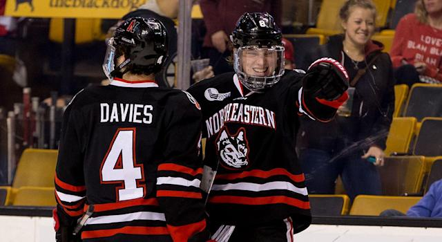 "Adam Gaudette (right) of the <a class=""link rapid-noclick-resp"" href=""/ncaab/teams/nay/"" data-ylk=""slk:Northeastern Huskies"">Northeastern Huskies</a> celebrates a goal with teammate Jeremy Davies (left). (Richard T Gagnon/Getty Images)"
