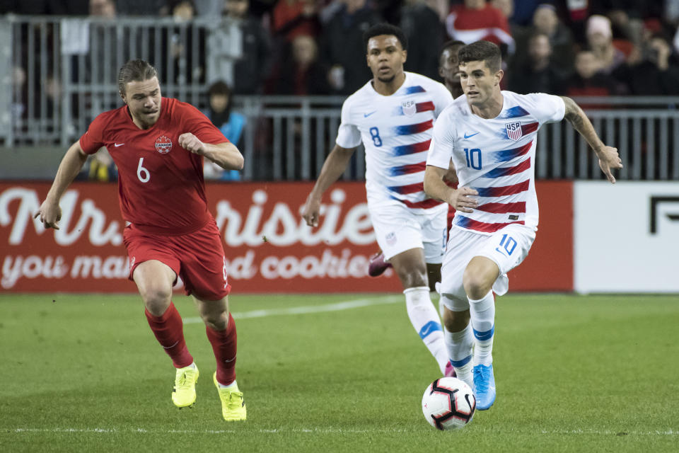 TORONTO, CANADA - 2019/10/15: Christian Pulisic (10) and Samuel Piette (6) are seen in action during the Nations League qualifier game between Canada and USA at Bmo field in Toronto. (Final score; Canada 2:0 USA). (Photo by Angel Marchini/SOPA Images/LightRocket via Getty Images)