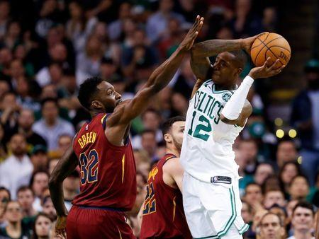 May 15, 2018; Boston, MA, USA; Boston Celtics guard Terry Rozier (12) looks to pass the ball around Cleveland Cavaliers forward Jeff Green (32) during the second quarter of game two of the Eastern conference finals of the 2018 NBA Playoffs at TD Garden. Mandatory Credit: Greg M. Cooper-USA TODAY Sports