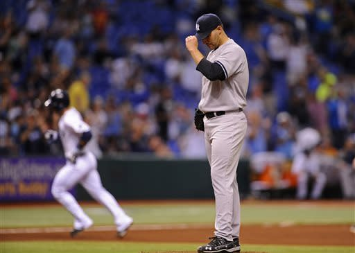 New York Yankees starting pitcher Andy Pettitte, right, reacts on the mound as Tampa Bay Rays' Sean Rodriguez rounds the bases after hitting a solo home run during the sixth inning of a baseball game on Wednesday, April 24, 2013, in St. Petersburg, Fla. (AP Photo/Brian Blanco)
