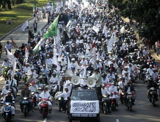 Indonesian Islamic hardliners march towards the US embassy in Jakarta in a protest against US pop diva Lady Gaga's upcoming Jakarta concert. Police in Indonesia, after refusing a permit for Lady Gaga to perform in the capital, say they are considering an offer from her local promoters to tone down her racy show