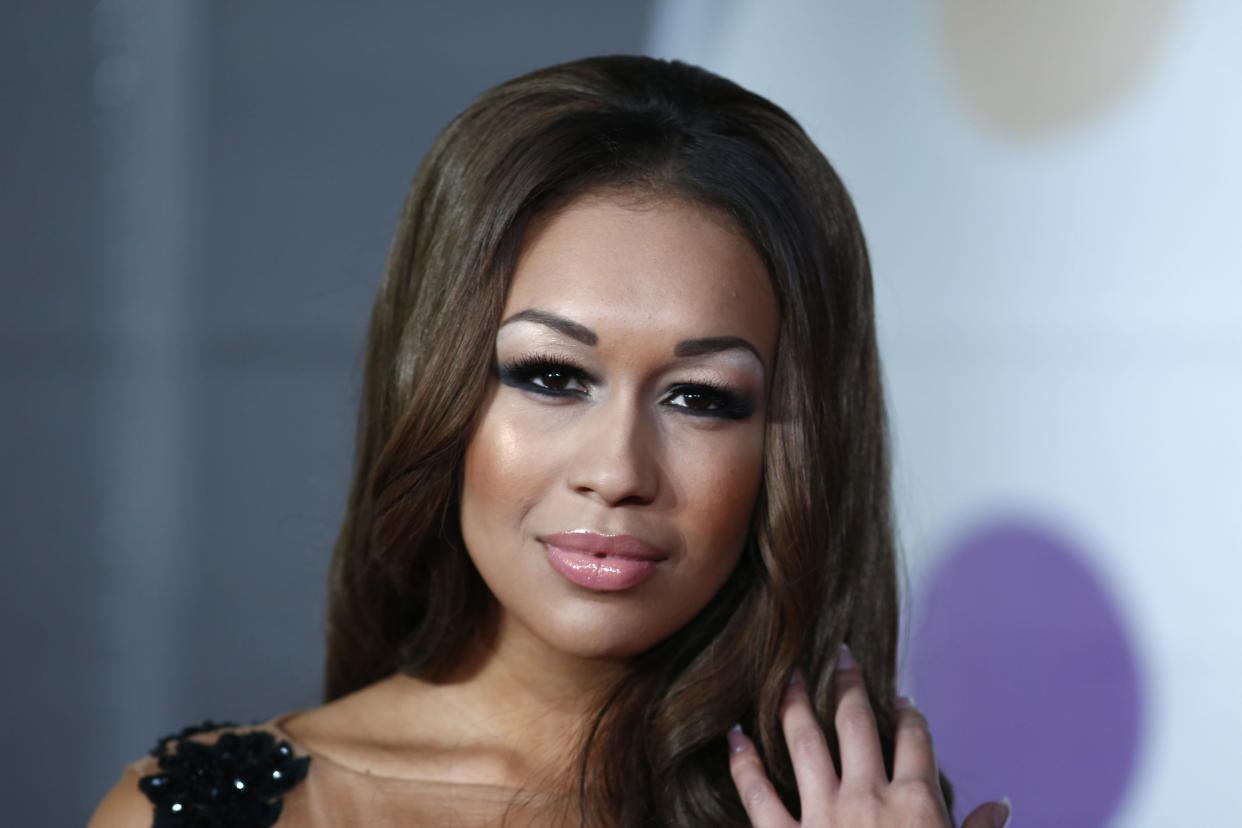 British singer-songwriter Rebecca Ferguson poses on the red carpet arriving at the BRIT Awards 2013 in London on February 20, 2013.   AFP PHOTO / ANDREW COWIE        (Photo credit should read ANDREW COWIE/AFP via Getty Images)