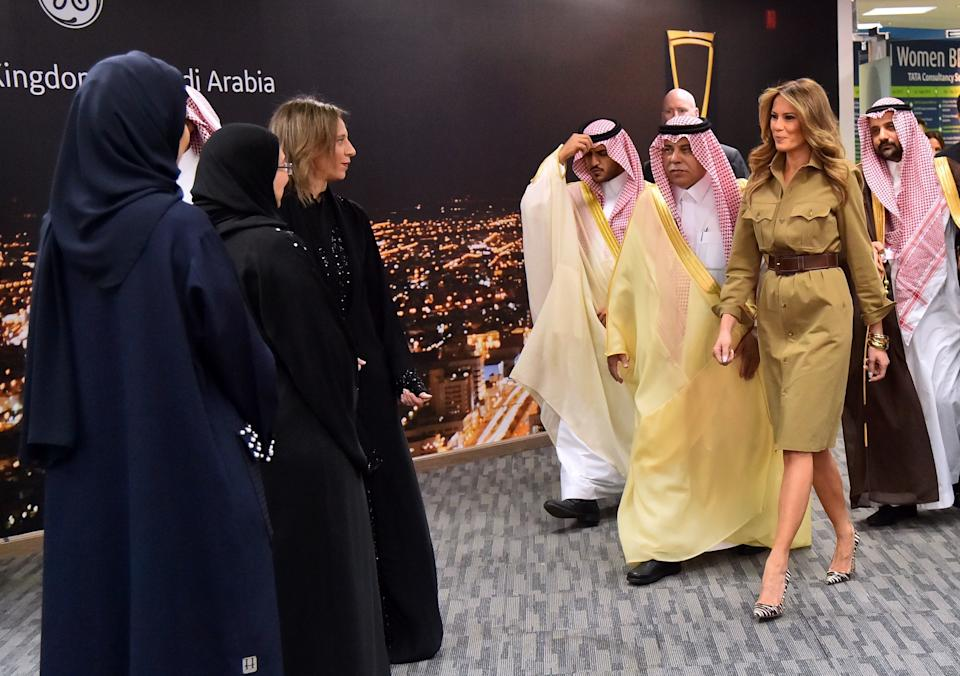 Melania Trump walks alongside Saudi Commerce and Investment Minister Majed al-Qasabi (center), as she visits the GE All-Women Business Process Services and IT Centre on May 21, 2017, in Riyadh.