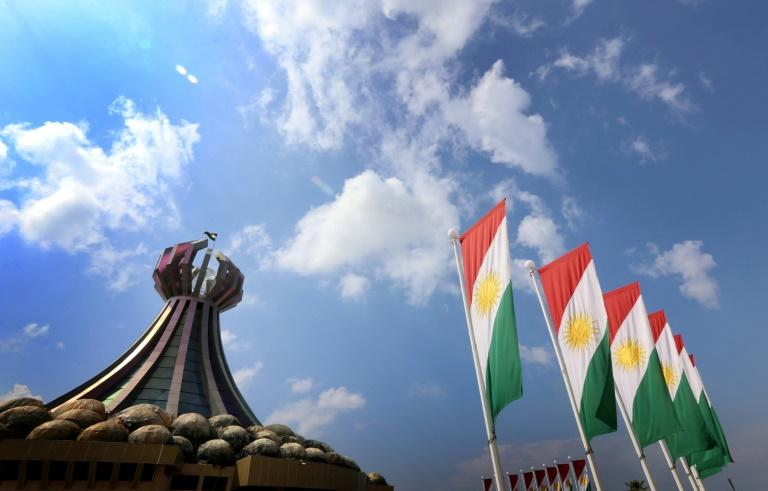 In this file photo taken on March 16, 2014 Kurdish flags flutter close to a monument for victims of the 1988 gas attack on the town of Halabja