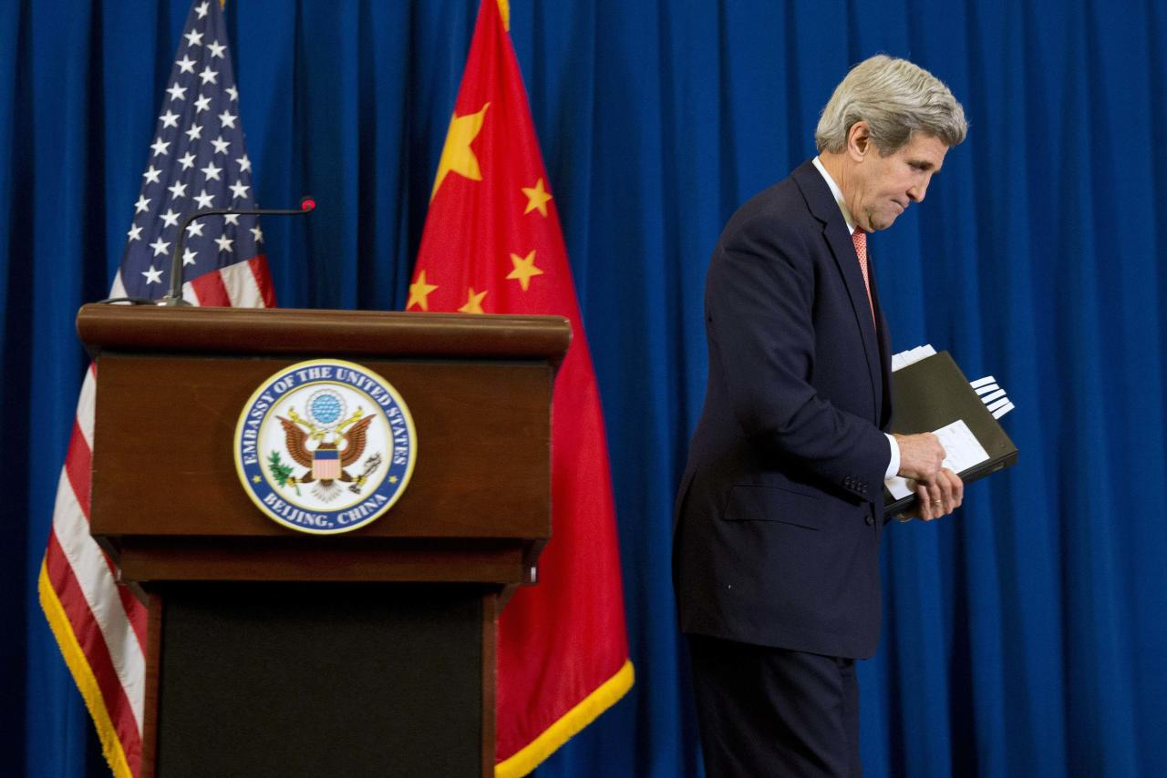 U.S. Secretary of State John Kerry walks off after a news conference in Beijing February 14, 2014. Kerry said on Friday that President Barack Obama has asked for possible new policy options on Syria given the worsening humanitarian situation there. REUTERS/Evan Vucci/Pool (CHINA - Tags: POLITICS)