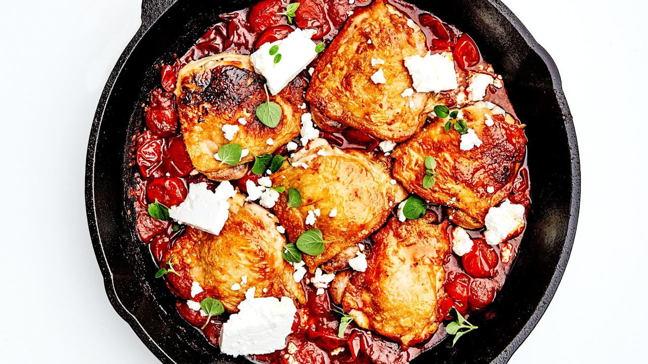 """Quick-cooking, budget-friendly, and pretty hard to screw up (that dark meat is automatically juicier), chicken thighs are our default weeknight dinner—and this is our simplest recipe yet. It's made in single pan in less than 45 minutes—and you don't even have to chop a vegetable. What's the shortcut? Harissa, a North African pepper-based hot sauce that's spicy, fruity, bright, and smoky—it brings the flavor so that you don't have to. While our friends over at BA.com might <a href=""""https://www.bonappetit.com/recipe/homemade-harissa?mbid=synd_yahoo_rss"""">make their own harissa</a>, we're saving time and buying a jar at the grocery store. Look for brands that list peppers as the first ingredient (sometimes they can be cut with tomato product, and that's not what you want) and taste it before you add it to the skillet: Different brands vary in spiciness, so you may have to go up or down in quantity depending. We love the version made by <a href=""""https://www.nyshuk.com/"""">NY SHUK</a>. <a href=""""https://www.bonappetit.com/recipe/one-pan-chicken-thighs-with-burst-tomatoes-harissa-and-feta?mbid=synd_yahoo_rss"""">See recipe.</a>"""