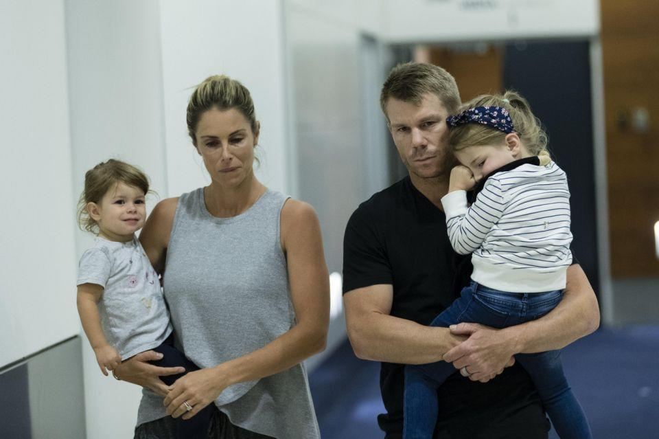 David and Candice Warner with their daughters Ivy and Indi at Sydney airport. Source: Getty
