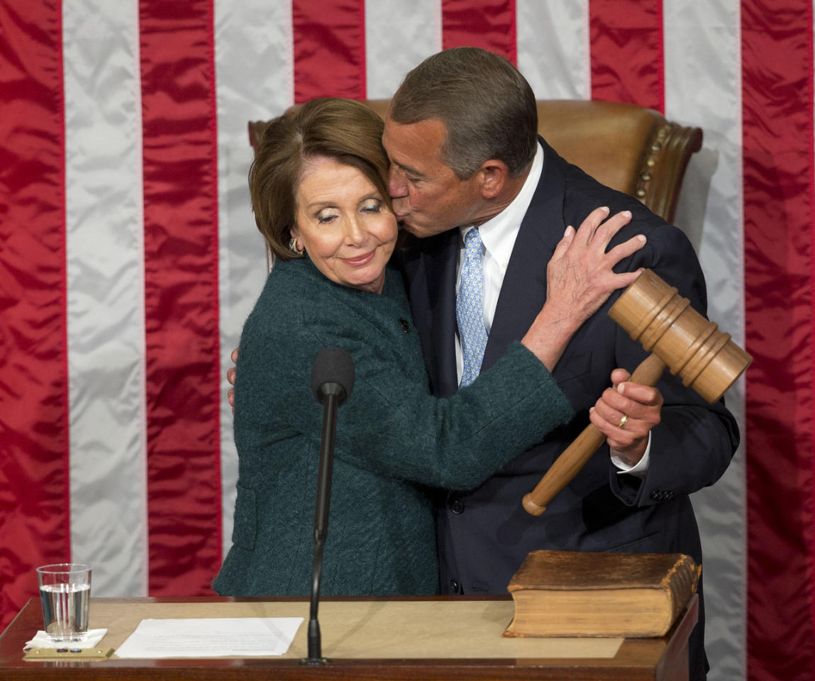 <p>House Speaker John Boehner, R-Ohio, kisses House Minority Leader Nancy Pelosi, D-Calif., after being re-elected to a third term during the opening session of the 114th Congress, as Republicans assume full control for the first time in eight years. <i>(Photo: Pablo Martinez Monsivais/AP)</i></p>