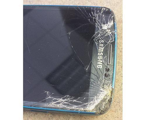 Samsung phone after being struck by lawn mower