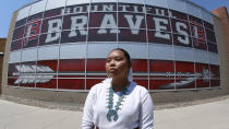 Lemiley Lane, a Bountiful junior who grew up in the Navajo Nation in Arizona, poses for a photograph at Bountiful High School, July 21, 2020, in Bountiful, Utah. While advocates have made strides in getting Native American symbols and names changed in sports, they say there's still work to do mainly at the high school level, where mascots like Braves, Indians, Warriors, Chiefs and Redskins persist. (AP Photo/Rick Bowmer)