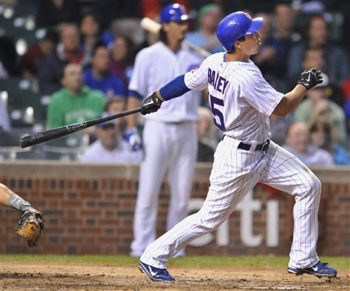 Chicago Cubs' Darwin Barney watches his two-run home run against the Houston Astros In the second inning during a baseball game in Chicago, Monday, Aug. 13, 2012. (AP Photo/Paul Beaty)