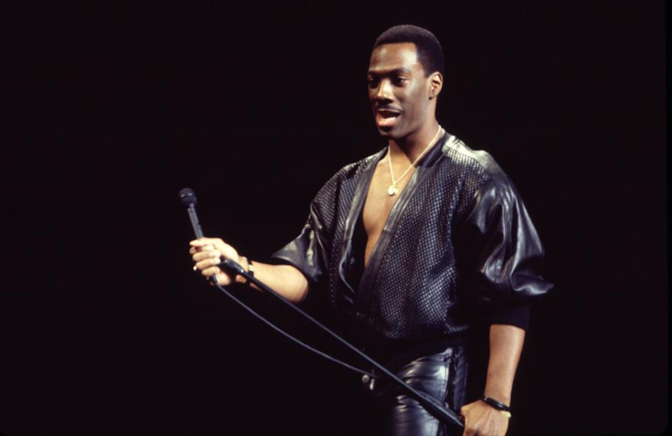 Eddie Murphy performs at Madison Square Garden during his 'Raw Tour' on October 13, 1987. (Photo by Gary Gershoff/Getty Images)