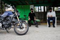 You Young-sik talks with a motorbike instructor during a training session amid the coronavirus disease (COVID-19) pandemic in Seoul