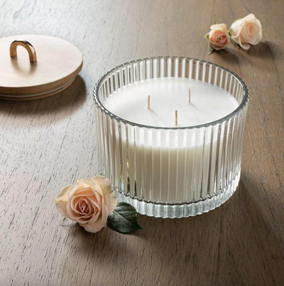 <p>This pretty <span>Masala Rose Wood Lidded Ribbed Glass Candle</span> ($15) smells of patchouli, vanilla, bergamot, rose, and cloves. </p>