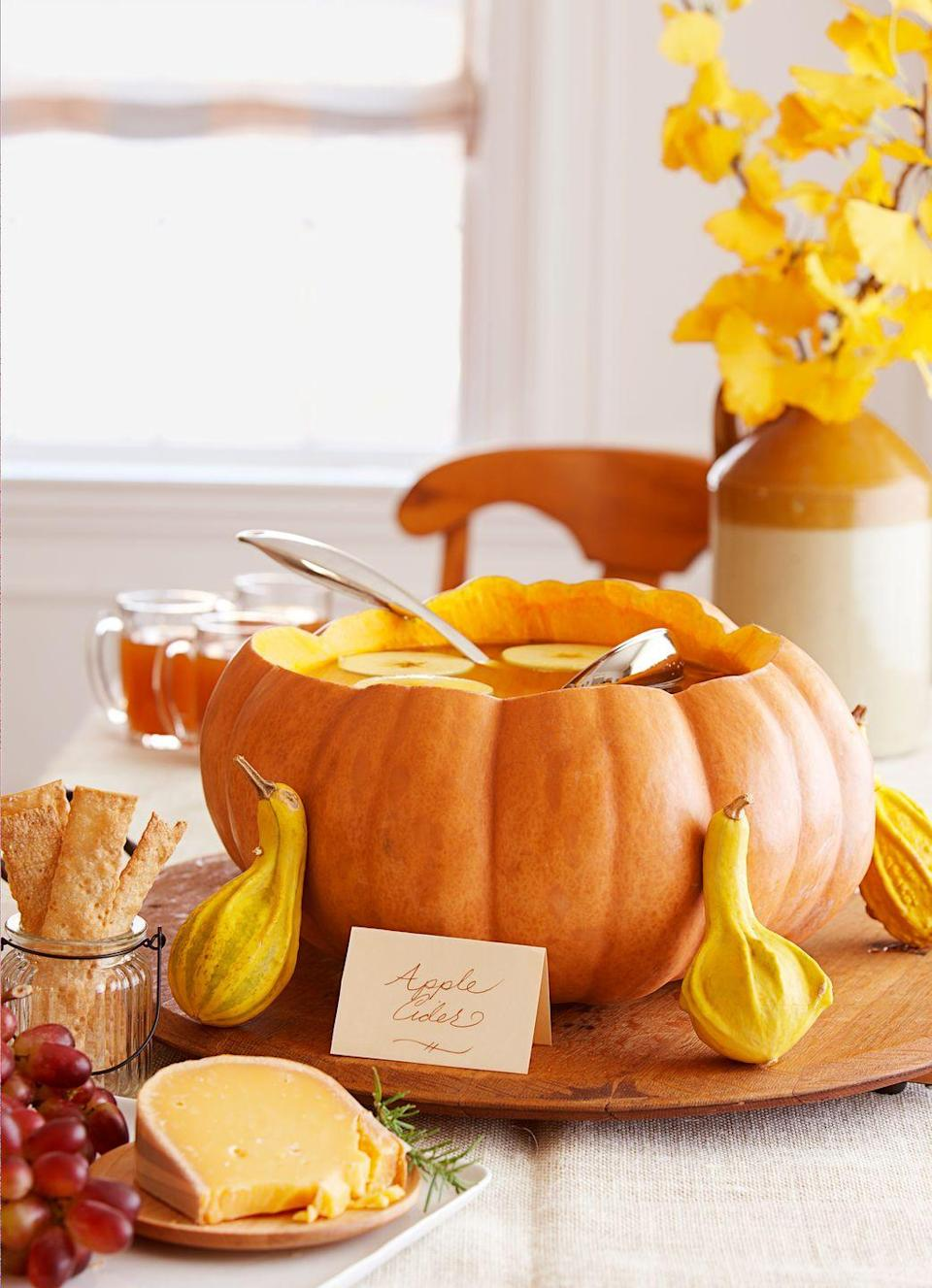 <p>Filled with cider, a hollowed-out pumpkin becomes an organic punch bowl. Plus, it's one less dish to wash during post-party clean-up. </p>