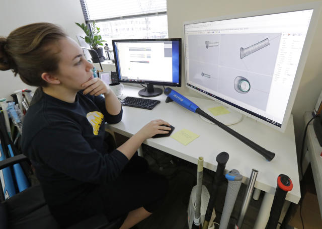 In this Feb. 8, 2018, photo, Kate Shreffler, a product designer for Axe Bat, works at a design station at the company's headquarters in Renton, Wash. Axe Bat is trying to revolutionize baseball with a simple concept -- a bat handle that is shaped like the handle of an axe. (AP Photo/Ted S. Warren)