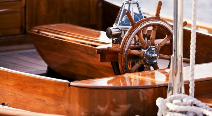 Wheel and cockpit on a beautiful wooden sailboat