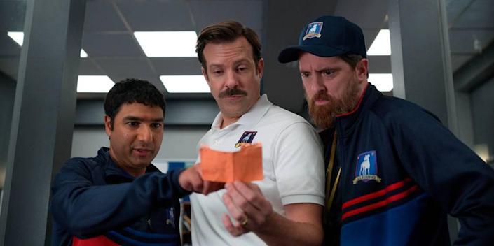 """The actors playing the """"Ted Lasso"""" coaches, from left, Nick Mohammed, Jason Sudeikis, and Brendan Hunt, are all nominated for Emmy Awards."""