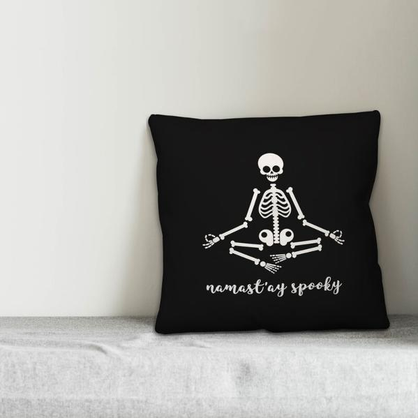 Stiefel Namastay Skeleton Throw Pillow (Image via Wayfair)