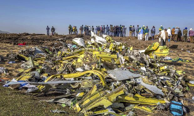 Wreckage is piled at the crash scene of an Ethiopian Airlines flight crash near Bishoftu, or Debre Zeit, south of Addis Ababa, Ethiopia, March 11, 2019. The crash killed 157 people. (AP Photo/Mulugeta Ayene)