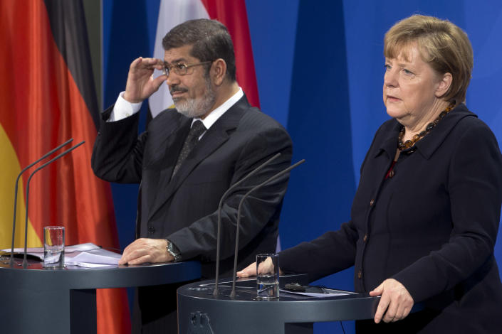 German Chancellor Angela Merkel, right, and President of Egypt Mohammed Morsi, left, address the media during a joint press conference after a meeting at the chancellery in Berlin, Germany, Wednesday, Jan. 30, 2013. (AP Photo/Michael Sohn)