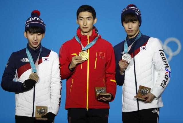 Medals Ceremony - Short Track Speed Skating Events - Pyeongchang 2018 Winter Olympics - Men's 500m - Medals Plaza - Pyeongchang, South Korea - February 23, 2018 - Gold medalist Wu Dajing of China, silver medalist Hwang Dae-heon of South Korea and bronze medalist Lim Hyo-jun of South Korea on the podium. REUTERS/Kim Hong-Ji