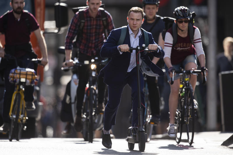 Workers cycle near London Bridge towards the City of London. Photo: Dan Kitwood/Getty Images