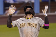 San Diego Padres' Fernando Tatis Jr. celebrates his solo home run as he scores during the fifth inning of a baseball game against the Los Angeles Dodgers Friday, April 23, 2021, in Los Angeles. (AP Photo/Mark J. Terrill)
