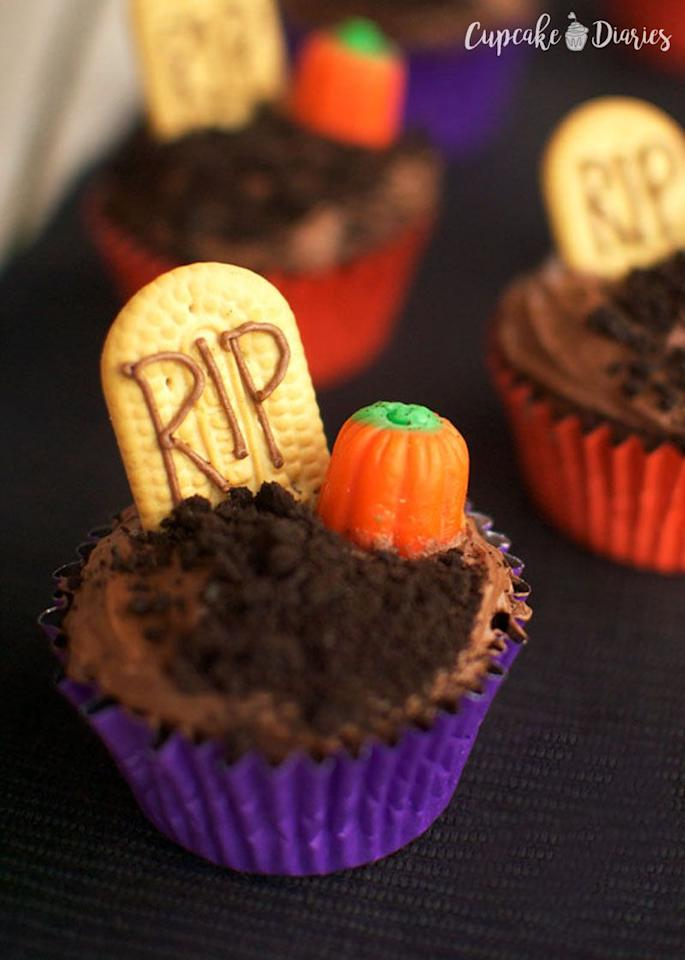 """<p>Turn your dessert table into a haunted graveyard with these cupcakes. How spooky is that?</p><p><strong>Get the recipe at <a href=""""https://www.cupcakediariesblog.com/2014/09/graveyard-cupcakes-30-days-halloween-day-1.html"""" target=""""_blank"""">Cupcake Diaries</a>.</strong></p><p><strong><strong><a class=""""body-btn-link"""" href=""""https://www.amazon.com/Wilton-Non-Stick-Muffin-Cupcake-Baking/dp/B00KIFBI1C/?tag=syn-yahoo-20&ascsubtag=%5Bartid%7C10050.g.1366%5Bsrc%7Cyahoo-us"""" target=""""_blank"""">SHOP CUPCAKE TINS</a></strong><br></strong></p>"""