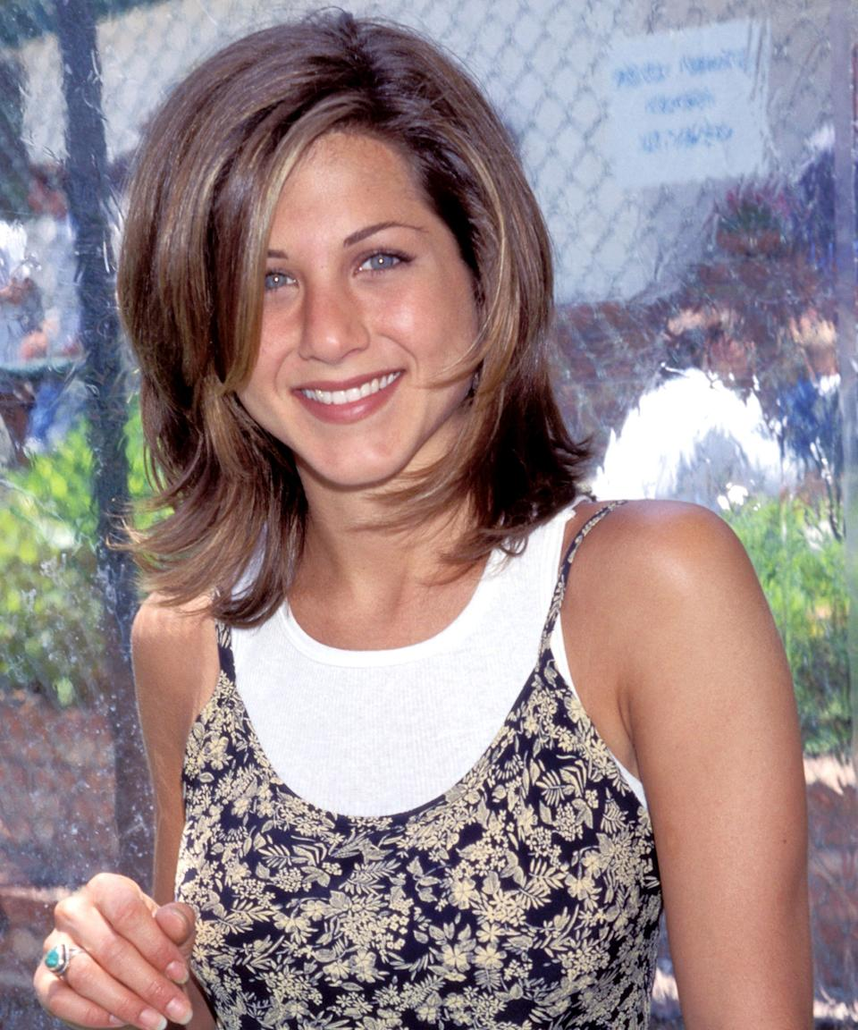 """<h3>1995: """"The Rachel""""</h3><br>Who could ever forget """"The Rachel""""? Aniston's longtime hairstylist Chris McMillan gave the actress this short, choppy cut early in her career — and, like the sitcom, it came to define the '90s.<span class=""""copyright"""">Photo: Kevin Mazur/WireImage.</span>"""