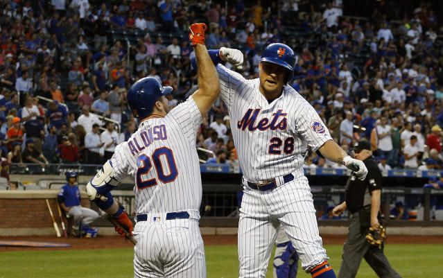 Aug 29, 2019; New York City, NY, USA; New York Mets left fielder J.D. Davis (28) is congratulated by first baseman Pete Alonso (20) after hitting a solo home run against the Chicago Cubs during the first inning at Citi Field. Mandatory Credit: Andy Marlin-USA TODAY Sports