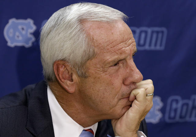 North Carolina coach Roy Williams listen to a reporter's question during the team's NCAA college basketball media day in Chapel Hill, N.C., Thursday, Sept. 26, 2013. (AP Photo/Gerry Broome)