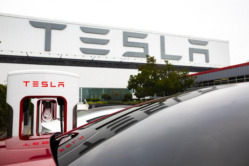 Tesla splits stock to make richly valued shares reachable again