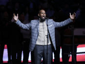 FILE - In this Nov. 17, 2015, file photo, R. Kelly performs the national anthem before an NBA basketball game between the Brooklyn Nets and the Atlanta Hawks in New York. A federal jury in New York convicted the R&B superstar Monday, Sept. 27, 2021, in a sex trafficking trial. (AP Photo/Frank Franklin II, File)