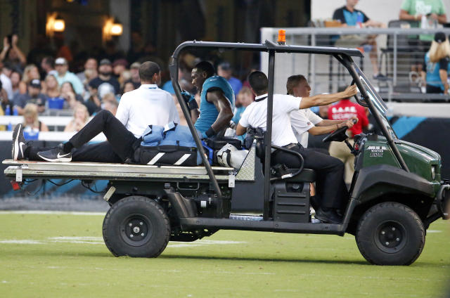 Jacksonville Jaguars wide receiver Marqise Lee, center, is taken off the field after he was injured during the first half of the team's NFL preseason football game against the Atlanta Falcons, Saturday, Aug. 25, 2018, in Jacksonville, Fla. (AP Photo/Stephen B. Morton)