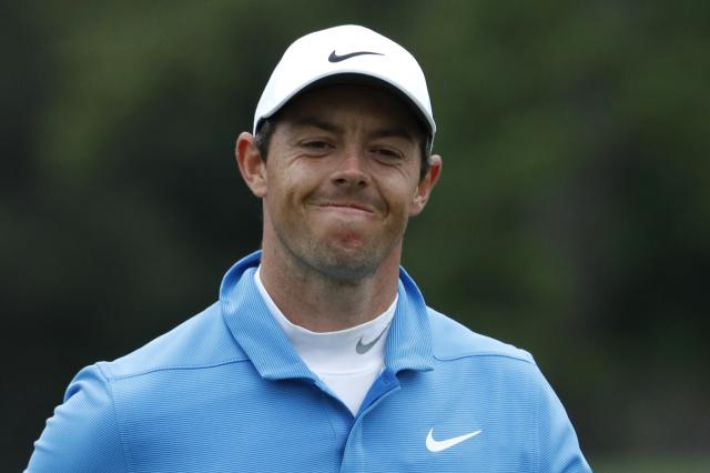 Rory McIlroy of Northern Ireland reacts to missing his putt on the ninth hole during third round play of the 2018 Masters golf tournament at the Augusta National Golf Club in Augusta, Georgia, U.S. April 7, 2018. REUTERS/Jonathan Ernst