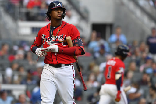 Atlanta Braves center fielder Ronald Acuna Jr. (13) walks back to the dugout after striking out against the St. Louis Cardinals in the fifth inning during Game 2 of a best-of-five National League Division Series, Friday, Oct. 4, 2019, in Atlanta. (AP Photo/John Amis)