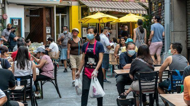 PHOTO: People dine outside in Chinatown in New York on August 15, 2020. (Richard B. Levine/Newscom)