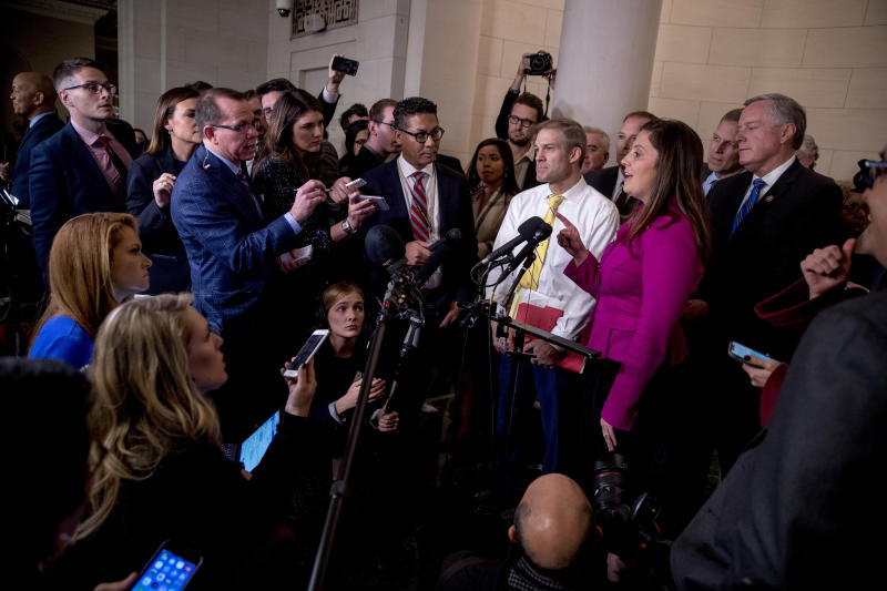 Rep. Elise Stefanik, R-N.Y., second from right, accompanied by Rep. Jim Jordan, R-Ohio, third from right, Rep. Mark Meadows, R-N.C., right, and other Republican lawmakers, speaks to members of the media following testimony from former U.S. Ambassador to Ukraine Marie Yovanovitch before the House Intelligence Committee on Capitol Hill in Washington, Friday, Nov. 15, 2019, during the second public impeachment hearing of President Donald Trump's efforts to tie U.S. aid for Ukraine to investigations of his political opponents. (Photo: Andrew Harnik/AP)