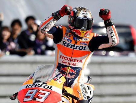 Honda MotoGP rider Marc Marquez of Spain celebrates after winning the Japanese Grand Prix and secured his third MotoGP championship in four years at the Twin Ring Motegi circuit in Motegi, Japan, October 16, 2016 in this photo released by Kyodo. Mandatory credit Kyodo/via REUTERS