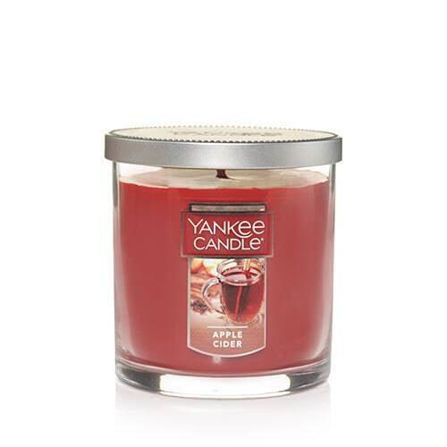 "<p>Give yourself or someone special the <a href=""https://www.popsugar.com/buy/Apple-Cider-Small-Tumbler-Candle-479702?p_name=Apple%20Cider%20Small%20Tumbler%20Candle&retailer=yankeecandle.com&pid=479702&price=17&evar1=casa%3Aus&evar9=46496957&evar98=https%3A%2F%2Fwww.popsugar.com%2Fphoto-gallery%2F46496957%2Fimage%2F46497083%2FApple-Cider-Small-Tumbler-Candle&list1=fall%2Ccandles%2Cyankee%20candle&prop13=api&pdata=1"" rel=""nofollow"" data-shoppable-link=""1"" target=""_blank"" class=""ga-track"" data-ga-category=""Related"" data-ga-label=""https://www.yankeecandle.com/product/apple-cider/_/R-1187884"" data-ga-action=""In-Line Links"">Apple Cider Small Tumbler Candle</a> ($17). With undertones of cinnamon, cloves, and nutmeg, you can't go wrong.</p>"