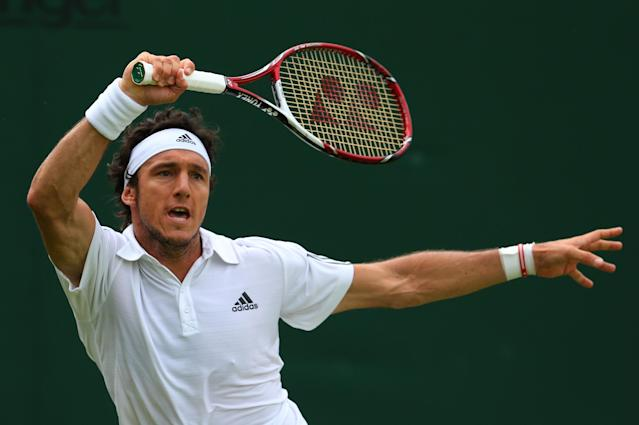 LONDON, ENGLAND - JUNE 26: Juan Monaco of Argentina plays a forehand during his Gentlemen's Singles second round match against Rajeev Ram of the United States of America on day three of the Wimbledon Lawn Tennis Championships at the All England Lawn Tennis and Croquet Club on June 26, 2013 in London, England. (Photo by Julian Finney/Getty Images)